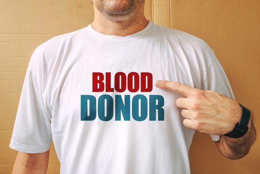 Proud volunteer blood donor wearing white t-shirt