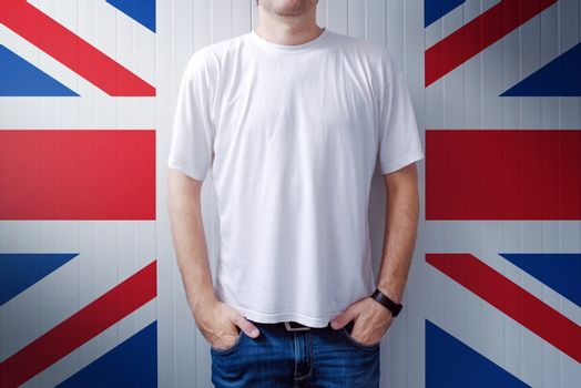 Man standing in front of United Kingdom flag wall