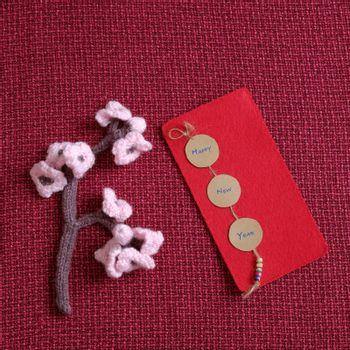 2016, year of monkey, handmade happy new year on red background, knitted monkey, funny stuffed animal, knit flower from yarn, red envelope for lucky money, sign for Vietnam Tet