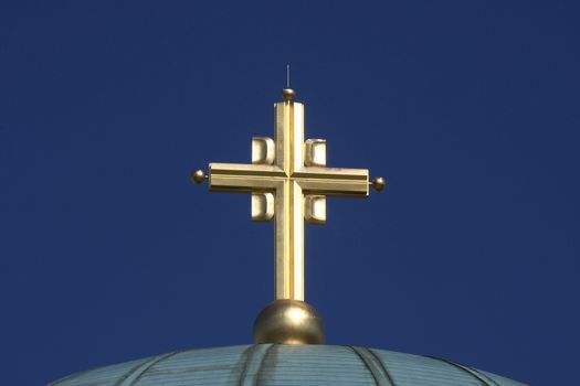 Golden cross on the top of temple