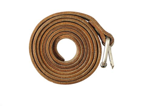 Coiled leather belt on a white background