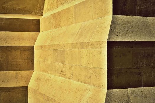 detail of oblique steps on a stone pillar