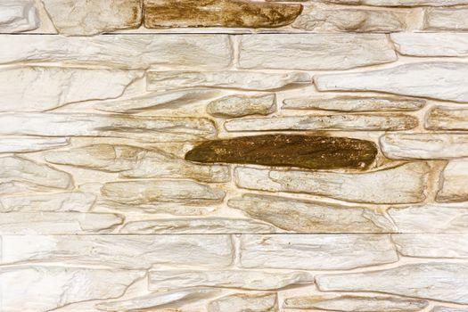 Old beige bricks wall pattern - background
