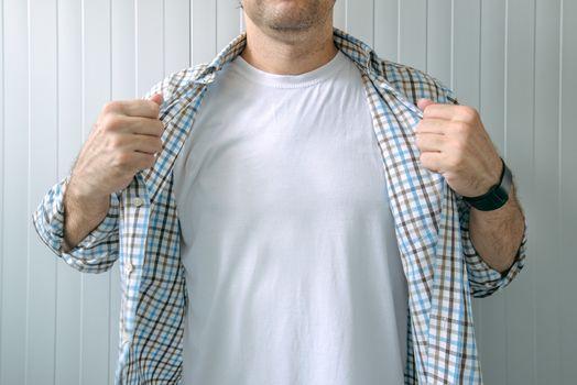 Guy revealing white t-shirt as copy space