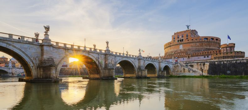 Castle of Holy Angel and Holy Angel Bridge over the Tiber River in Rome at sunset.