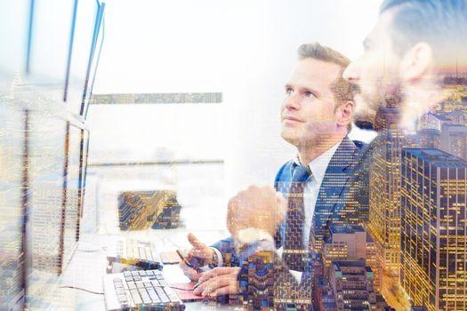 Successful businessmen in office. Business success.