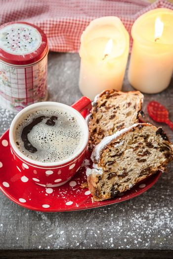 Cup of coffee and fruit loaf