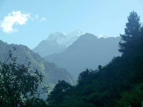 the Himalayan mountains with fog blue sky