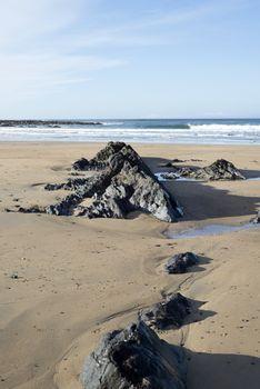 rock formations on sandy beach in Ballybunion Ireland