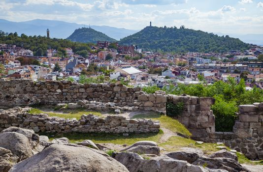 View of Plovdiv, Bulgaria downtown with ancient ruins in foreground.