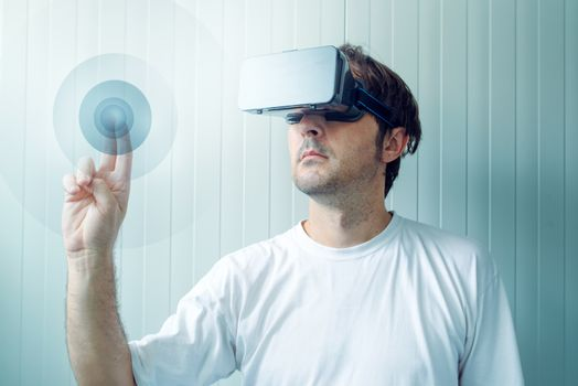 Man with VR goggles working in vurtual reality environment