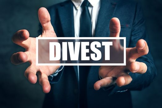 Divest concept with businessman in suit