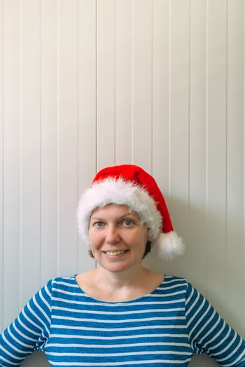 Happy woman with Christmas Santa Claus hat in cheerful mood