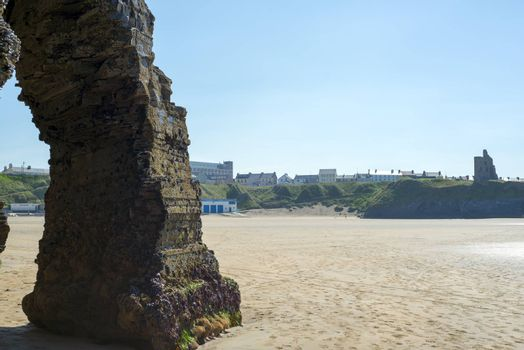 natural rock formation at the ballybunion cliffs with castle and beach