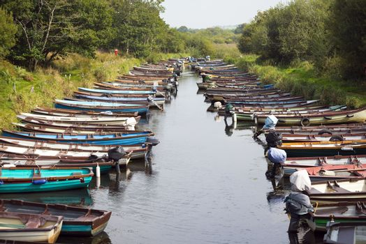 rowing boats moored at ross castle in killarney county kerry ireland