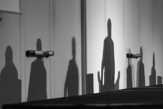 Silhouettes of leaders on a podium.