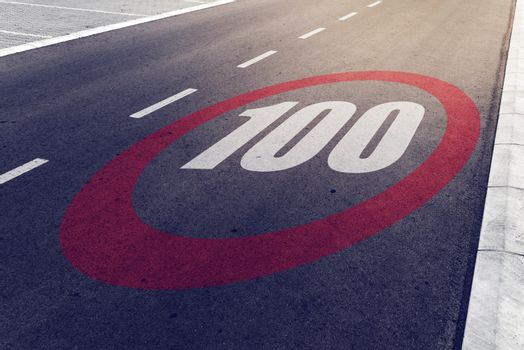 100 kmph or mph driving speed limit sign on highway