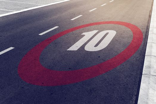 10 kmph or mph driving speed limit sign on highway