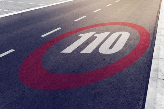 110 kmph or mph driving speed limit sign on highway