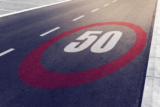 50 kmph or mph driving speed limit sign on highway