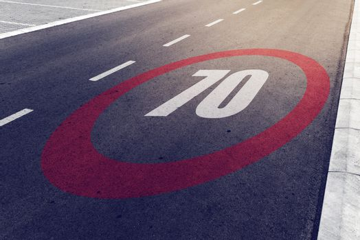 70 kmph or mph driving speed limit sign on highway