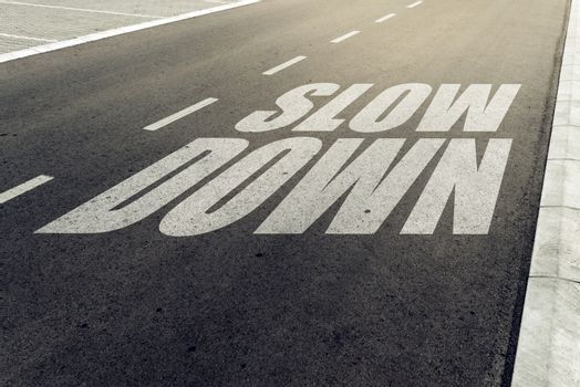 Slow down speed limit sign on highway