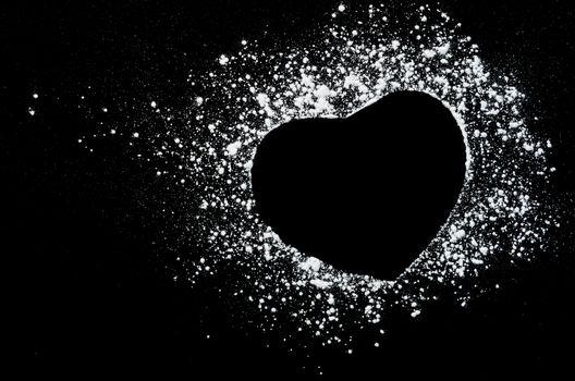 Freeze motion of white powder on black dark background