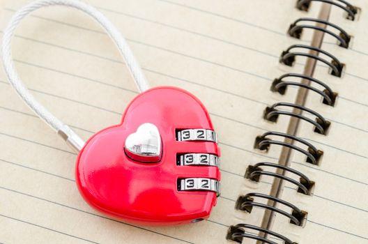Red master key heart shape lock.