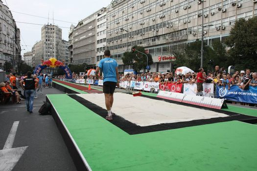 BELGRADE,SERBIA - SEPTEMBER 11 , 2016:Preparation of long jump runway for competition as promotion of European athletics indoors championship which will be held from 3-5.March ,2017 in Belgrade,Serbia