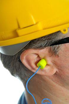 earplug into the ear