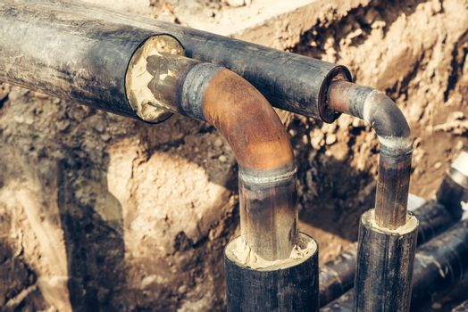 Maintenance of industrial pipes for heating water transport