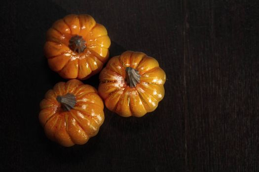 Three Halloween pumpkins on a wooden table