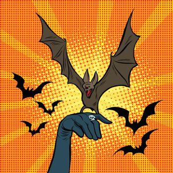 Evil bat sitting on the hand