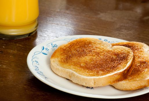 Two slices of toast and a side of OJ