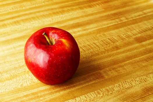 Apple sitting on the counter at home ready to eat for good health