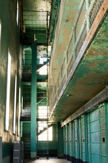 Worn out jail cells with paint that is comming off