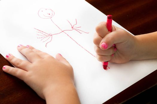 Child producing fine art with a crayon.