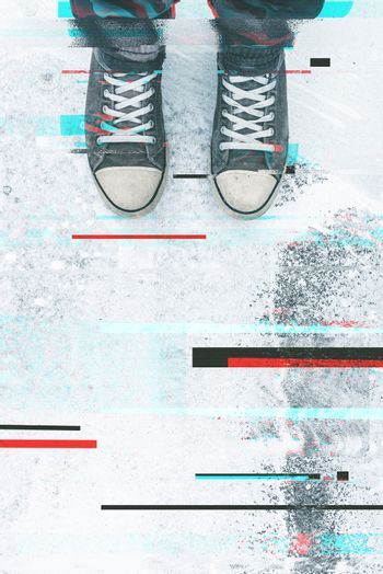 Pair of sneakers on pavement with digital glitch effect