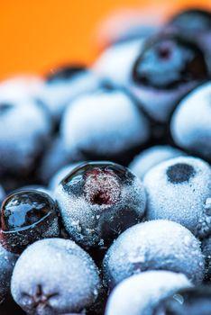 Frozen aronia berries in a bowl