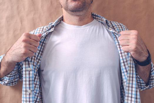 Man revealing white t-shirt as copy space