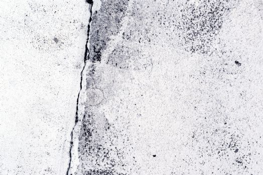 Crack in the concrete pavement as abstract background