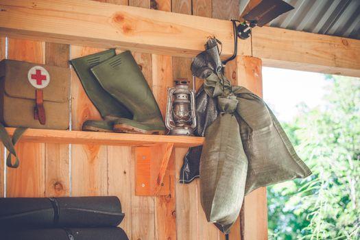 Retro survival kit in a wooden cabin