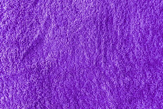 Texture of purple bathing towel as background