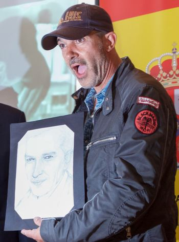 Sofia, Bulgaria - June 11, 2013: Antonio Banderas is reacting when given a drawing from a fan at Mati hall press conference during the 20th Film Festival of the hispanic and hibero hispanic movies in Sofia, Bulgaria.