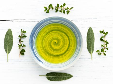 Alternative health care fresh herbal and fragrant oil in  a bowl