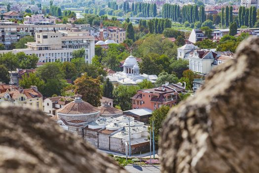 View of Plovdiv, Bulgaria downtown with old and new buildings and trees along Maritsa river.