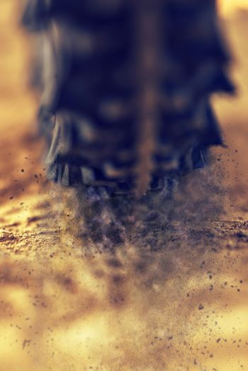 Mountain bike wheel close up with dirt dust particles