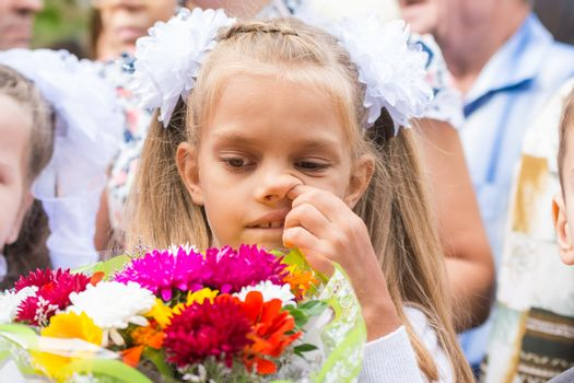 First grader on the first line in September picking his nose