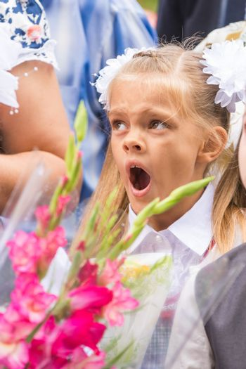First grader yawning on line the first of September