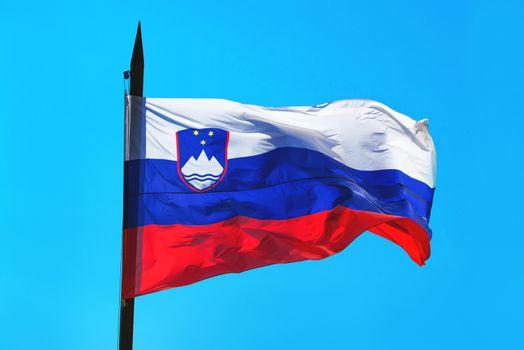Slovenia flag against blue sky